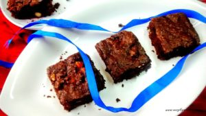 Eggfree and whole wheat almond brownies. These nutty chocolaty 'healthy' brownies are yummy and taste perfect with a scoop of vanilla ice cream.