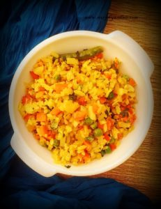 Vegetable poha made with beaten/ flattened rice flakes and an assortment of veggies is a perfect 'one-pot' meal to start your day.