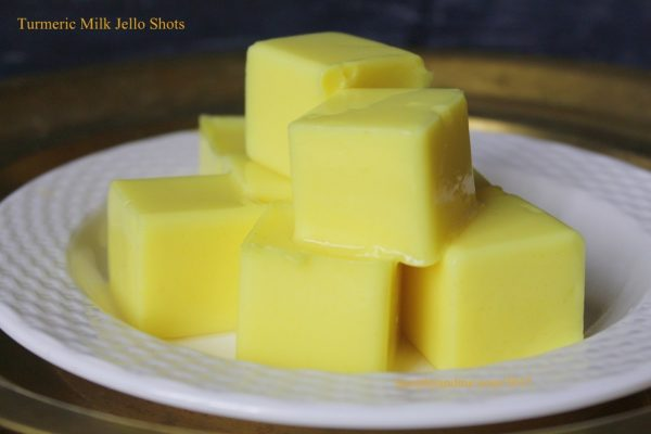 Jiggly wiggly turmeric milk jello shots. A super easy and quick treat for kids and adults alike. It is also a mom's hack to get your kids to drink milk!